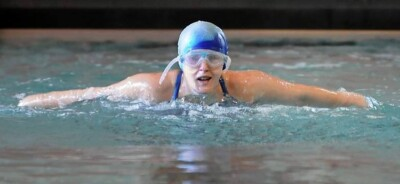 Abby Resnick competing in a swim competition.
