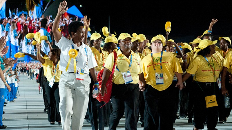 Loretta Claborne walking with a delegation of athletes.