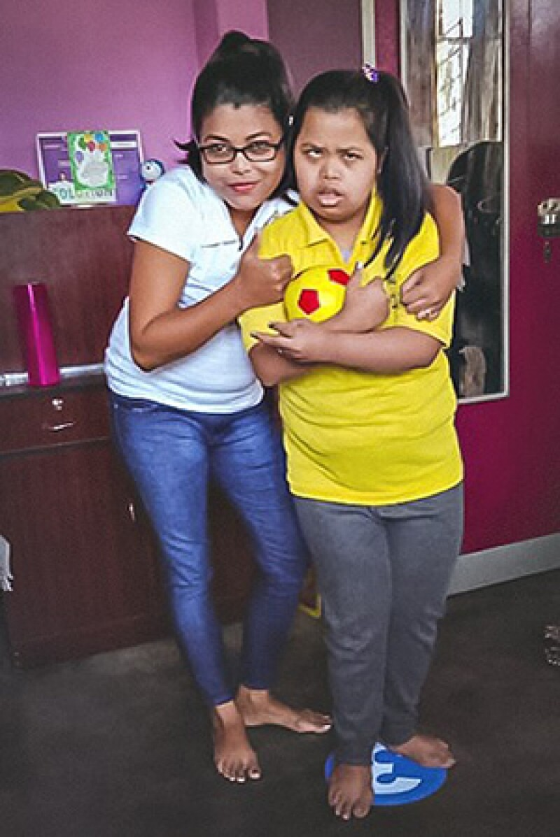 Rekha and her younger sister, Sagarika posing together.
