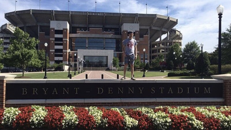 RJ takes a picture in front of Alabama's football stadium during orientation weekend.