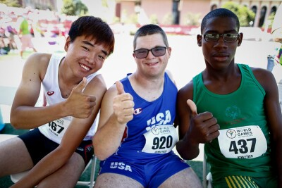 Three Special Olympics athletes giving a thumbs up at the 2015 World Games in Los Angeles