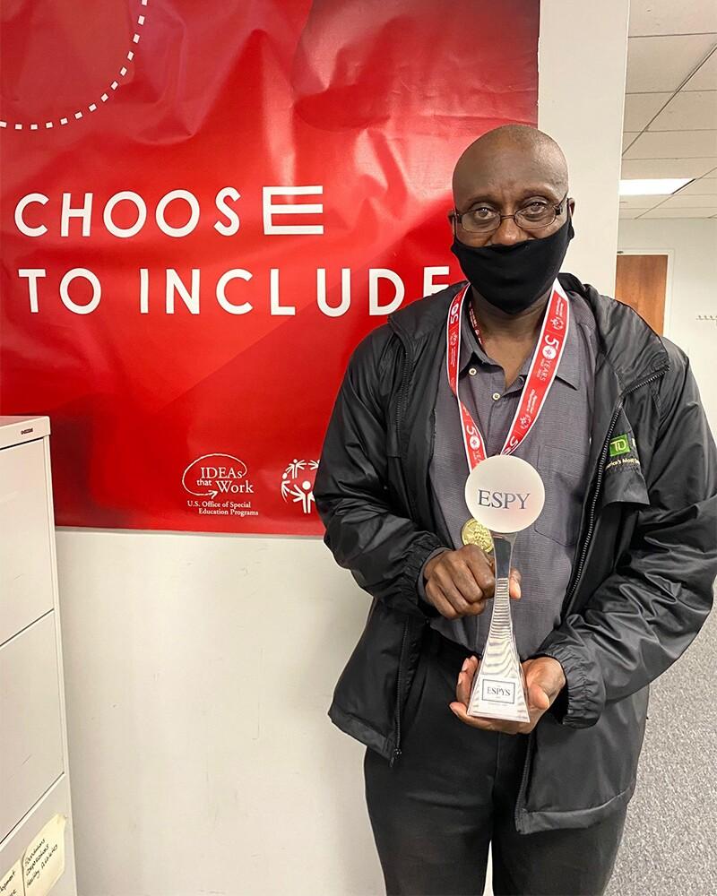 Rodney posing with the ESPY award.