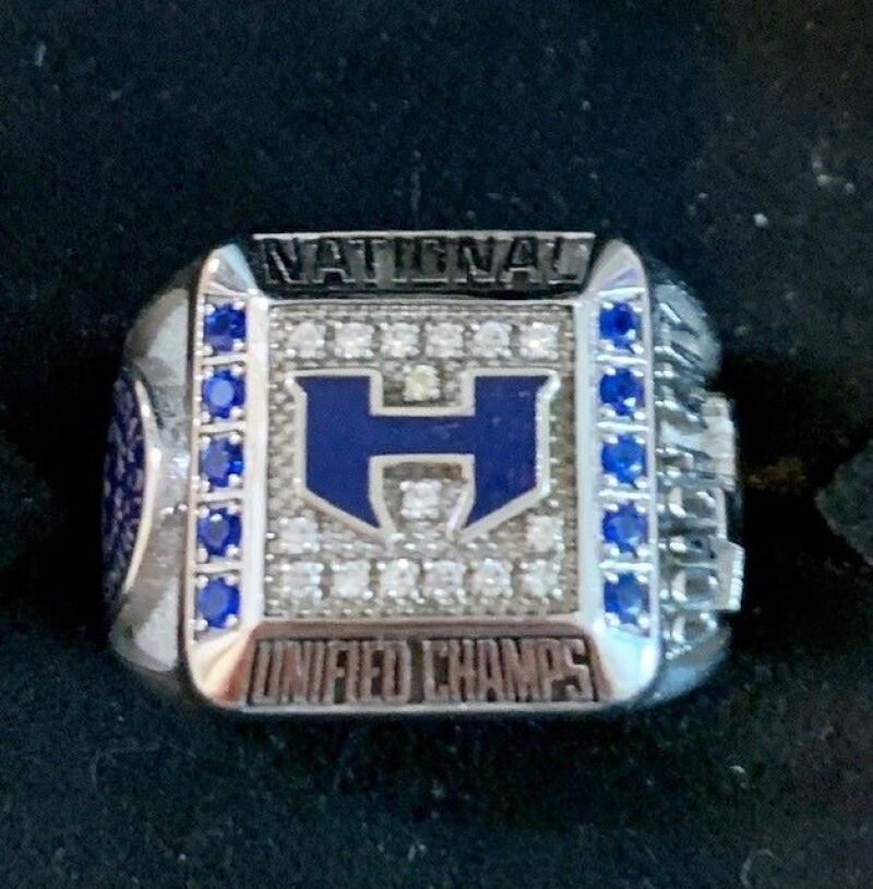 This photo shows a large ring covered in blue and white gems.