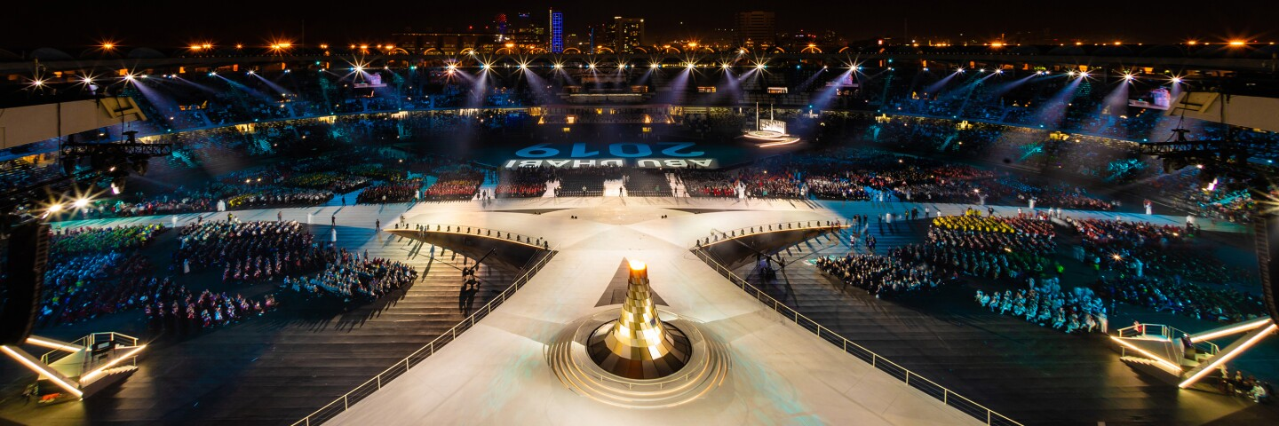 Stage in Abu Dhabi at the Abu Dhabi 2019 World Games; audience on either side of a lit stage.
