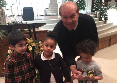 Pastor Roberts with three young children.