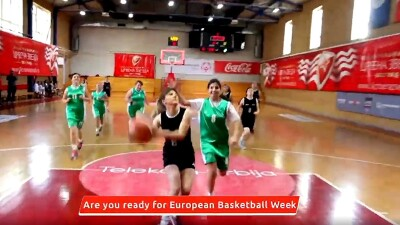 Female Unified team running down the court, girl in a black uniform leads and is preparing to throw the ball.