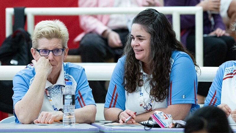Cindy Schopper sits with another female bowling coach.
