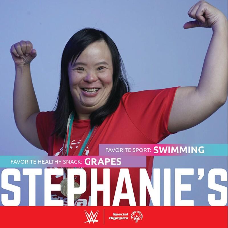 Stephanie Ching flexing her biceps.