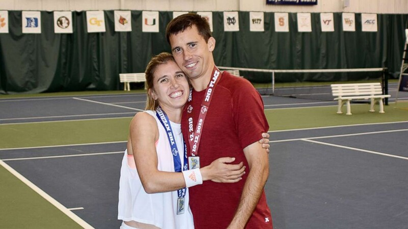 Brittany hugging her fiance Ryan on the tennis court