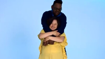 One individual hugging another