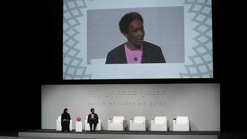 Loretta on stage speaking