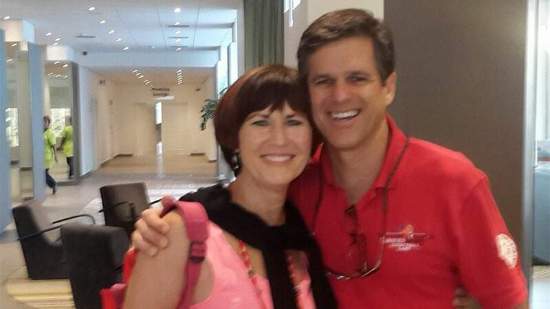 Tali posing with and smiling with Tim Shriver.