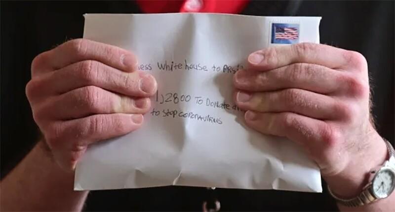 Steven holding an letter he sent to the White House.