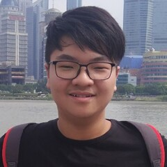 "Su Xing ""Jack"" Zheng smiling for a portrait photo."
