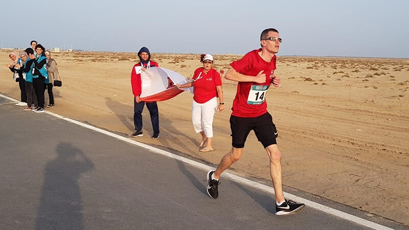 Francis Mauro, Special Olympics Gibraltar runner, running through the Abu Dhabi desert.