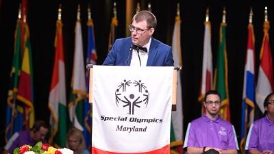 RJ Nealon speaks at podium.