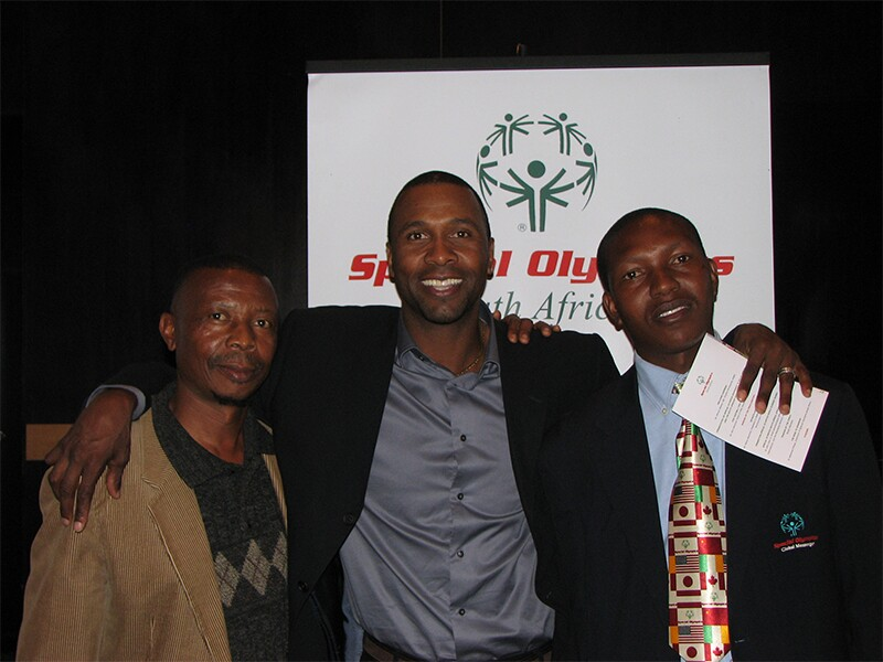 Ephraim Mohlakane standing with two other men to his right.