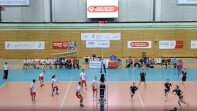 Volleyball game being played on the court.