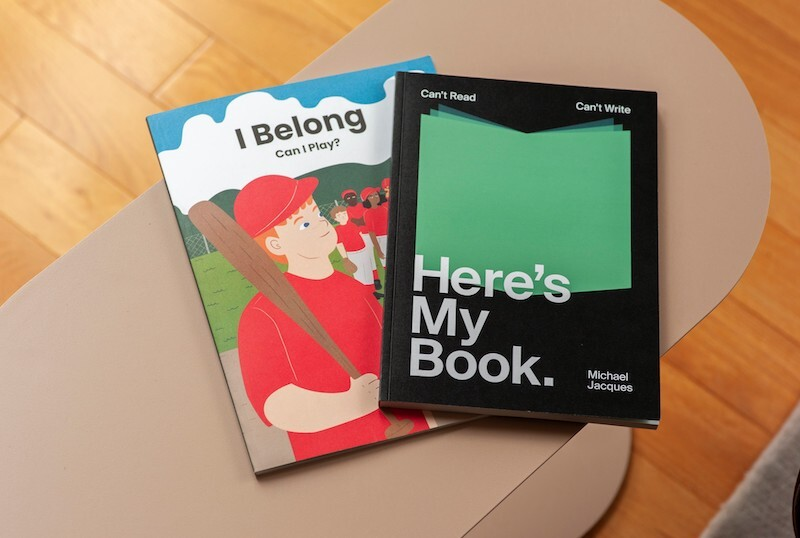Two books sit on a table.