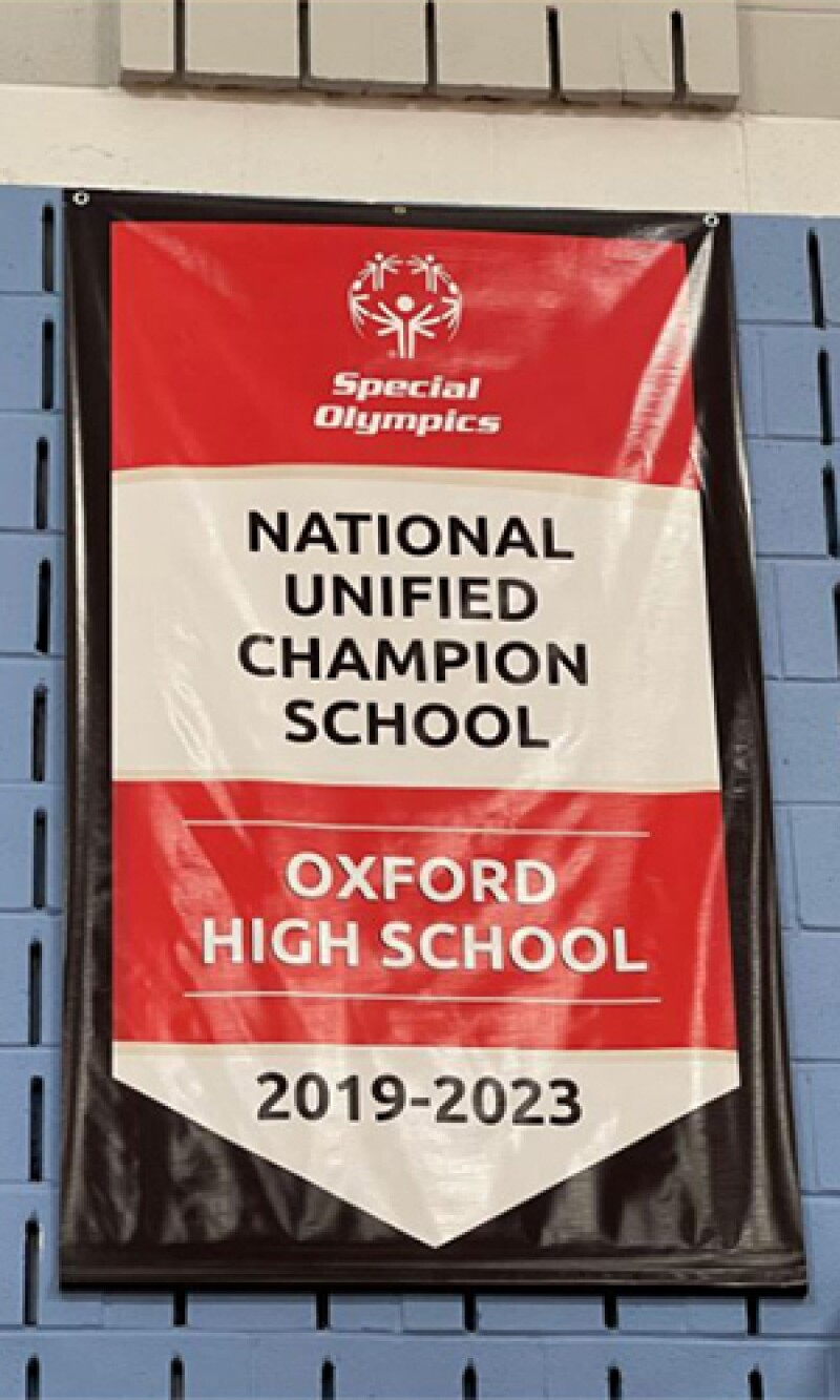 A banner sits in the school's gym as it's recognized as a National Unified Champion School.