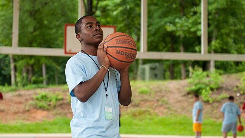 An athlete practices their basketball skills.