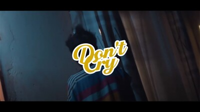 An image of a person walking away; text that reads: Don't Cry