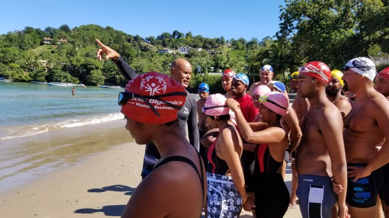Open water swimmers line up on the beach and get final instructions before the competitions.