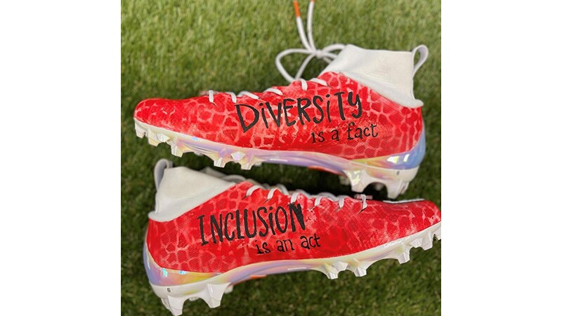 Baker Mayfield's Special Olympics Diversity is a fact, Inclusion is an act red cleat.