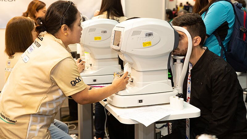 World Games Abu Dhabi 2019: athlete receiving an optical exam at a Healthy Athletes Opening Eyes event.