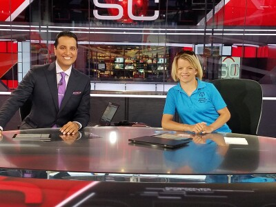 Daina Shilts and ESPN's Kevin Neghandhi on set at ESPN.