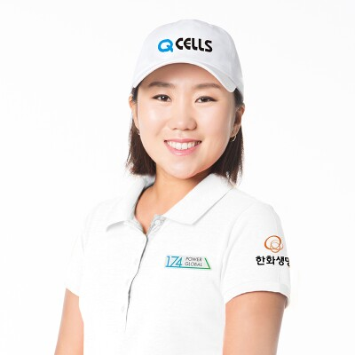 In-Kyung Kim smiling and wearing a power global branded polo