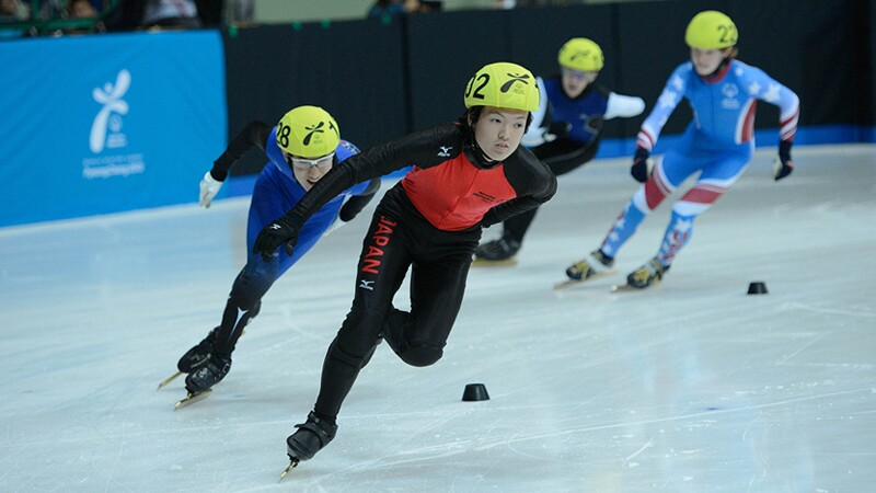 Short Track Speed Skaters racing on the ice in Pyeong Chang Korea.