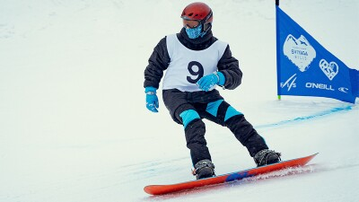 Special Olympics Russia athlete Gleb Abdullin snowboarding.