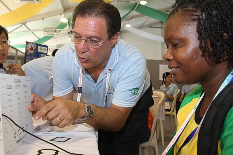 Dr. Paul Berman screening a woman at a screening event.