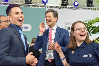Special Olympics International Board of Director Chair Timothy Shriver, Special Olympics Global Ambassador Apolo Ohno and Special Olympics Sargent Shriver International Global Messenger Hanna Joy Atkinson laughing.