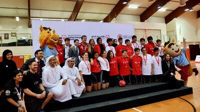 Athletes and representatives together in a group in front of a Unified Champions Schools and World Games 2019 logo backdrop.