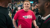 Peter Mullin (works for the Washington Wizards) at the game in a red shirt that reads: Wizards Power Pack. He's dancing and smiling.