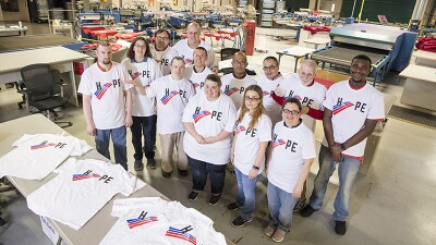 2018 SO Hope T-Shirt Story Shoot. Standing in a group on the work room floor: Bank of America Employee: Gabe Lotz, Andrea Moore, Brent Pfister, Daniel Gleeson, Matt Planer, Amanda Perry, Mark Reeves, Lisa Sadlowski, Wilson Caraballo, Kristin O'Grady, Fred Mammele, Tinielle Spicer-Watson (Current as of 10/15/18)