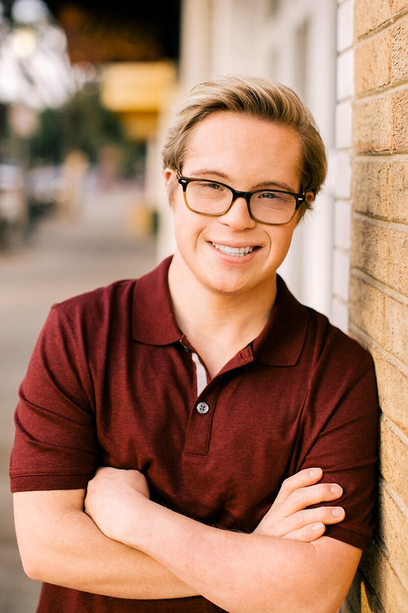 Professional headshot of Cole in a burgundy polo.
