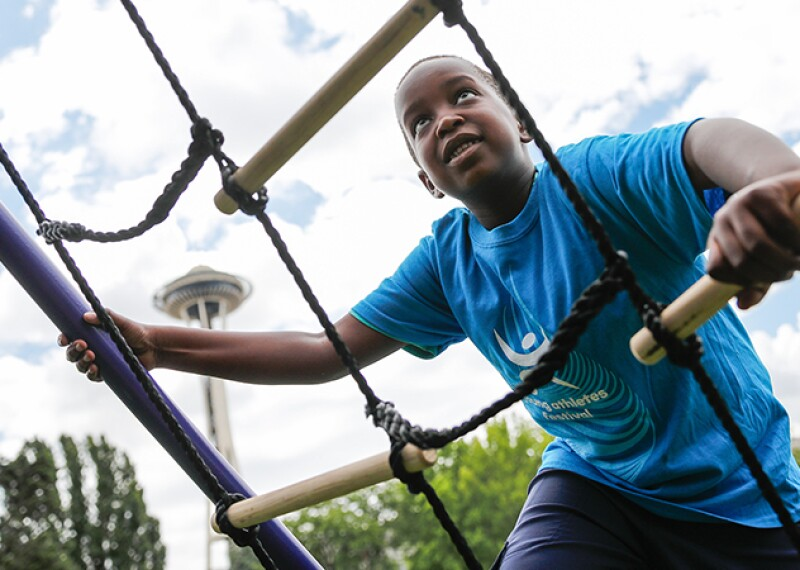 A Young Athletes participant climbs ropes during the USA Games.