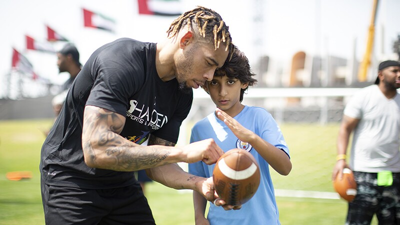 Joe Haden coaches athletes during the unified flag football at Zayed Sports City during the Special Olympics World Games in Abu Dhabi on March 16, 2019.