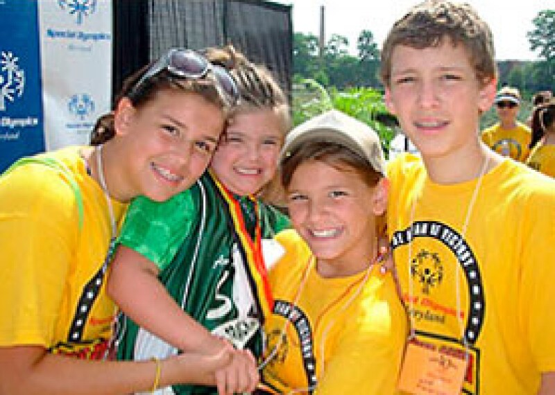 "Rosa Marcellino, 9, second from left, is shown with siblings Maddie, 13, Gigi, 11, and Nick, 15, during the Special Olympics state games, held in June. Rosa has Down syndrome and is the inspiration behind ""Rosa's Law"" that removes the terms ""mentally retarded"" and ""mental retardation"" from federal education, health and labor laws."