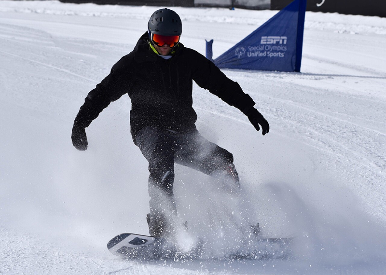 2019 X-Games snowboarder coming to a stop.