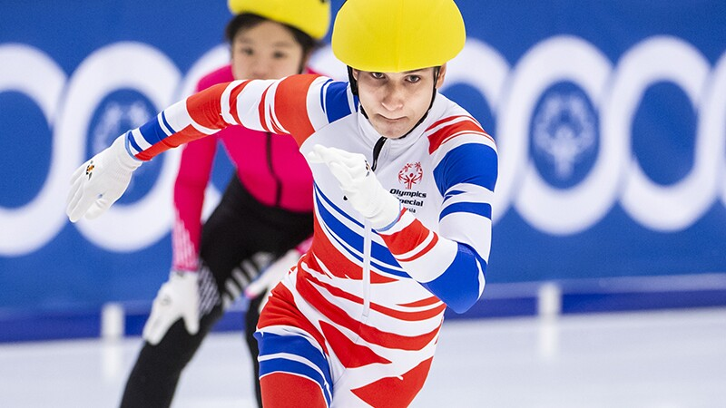 Two Short Track Speed Skaters in the rink racing.