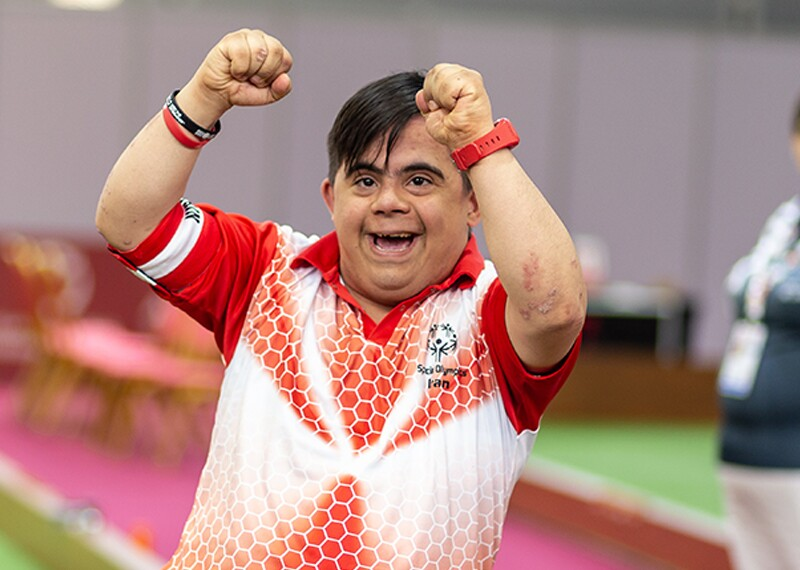 Male athlete from Iran cheering in victory.