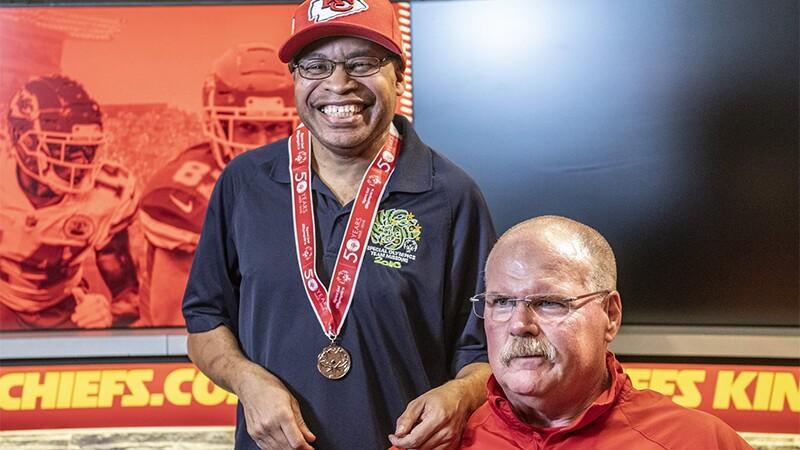 Special Olympics Missouri athlete Arthur Murphy poses with Kansas City Chiefs Head Coach Andy Reid.