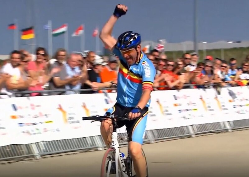 Cyclist fist pumping as he gets to the end of the race.