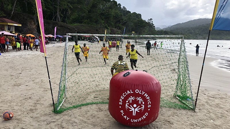 Athletes compete in the beach football gold medal game