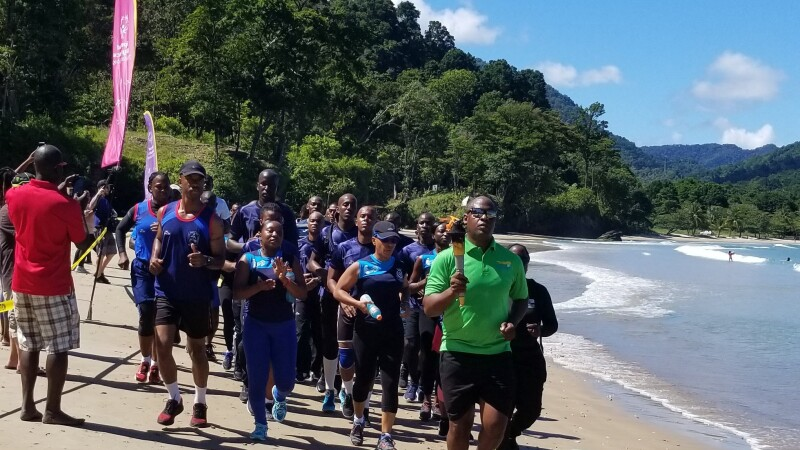 The first-ever Law Enforcement Torch Run at a Beach Game event. Law enforcement officers run along the beach between the water and designated flags.
