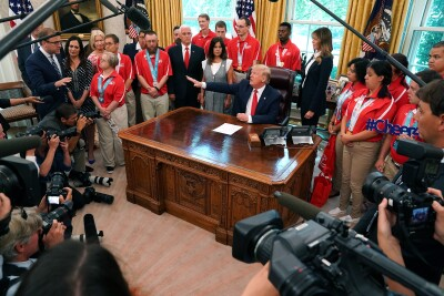 U.S. President Donald Trump, center, speaks during a meeting with members of the delegation that represented the USA at Special Olympics World Games Abu Dhabi 2019 in the Oval Office of the White House in Washington, D.C., U.S., on Thursday, July 18, 2019.